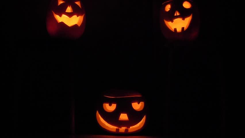 Halloween Background with three pumpkin face | Shutterstock HD Video #1018761223