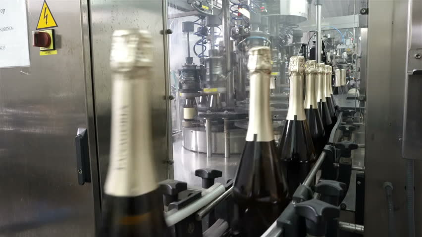 Sennoy, Russian Federation – February 15, 2018: The line for filling and sealing the conveyor in a factory of champagne | Shutterstock HD Video #1018774813