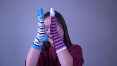 Girl with Down Syndrome have fun with different socks