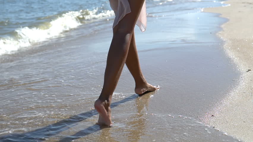 Sexy woman in bikini walking on the beach. she looks very happy with her vacation. | Shutterstock HD Video #1018863343