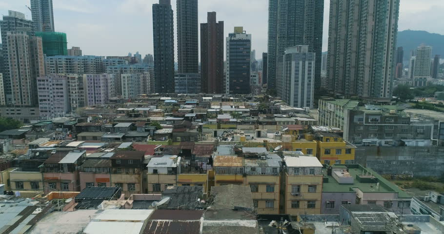 Drone view of crowded residential towers in an old community in Hong Kong. Scenery of overcrowded narrow apartments Urban district cityscape 4K aerial | Shutterstock HD Video #1018873573