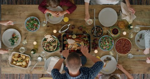 happy family eating thanksgiving meal together enjoying tasty homemade lunch holiday celebration feast overhead