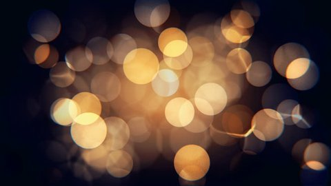 Abstract isolated blurred festive yellow orange lights with bokeh. Sparkling circular stars motion 3D animation. Holiday concept backdrop with twinkling bright shapes. Blinking Christmas Tree lights