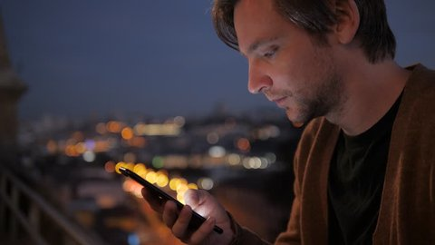 Man voice recognition with smart phone in park night hotel outdoor,