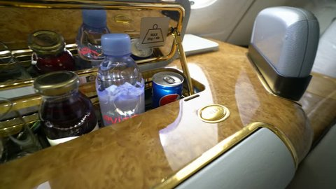 DUBAI,UAE - OCTOBER,2017: Emirates Airbus A380 interior- mini bar in FIRST CLASS SEAT. Emirates is one of two flag carriers of the United Arab Emirates along with Etihad Airways and is based in Dubai.