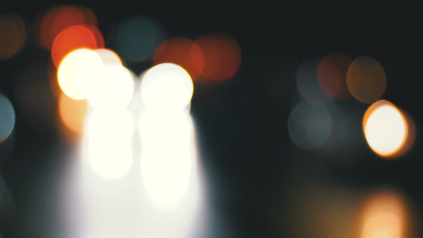 Defocused Night City Traffic Lights. Color Blurred bokeh of moving transport and typical city noise.