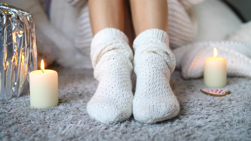 Cozy Winter Fall Season, Warm Knitted Socks. Woman Relaxing At Home. Comfy Hygge Lifestyle.