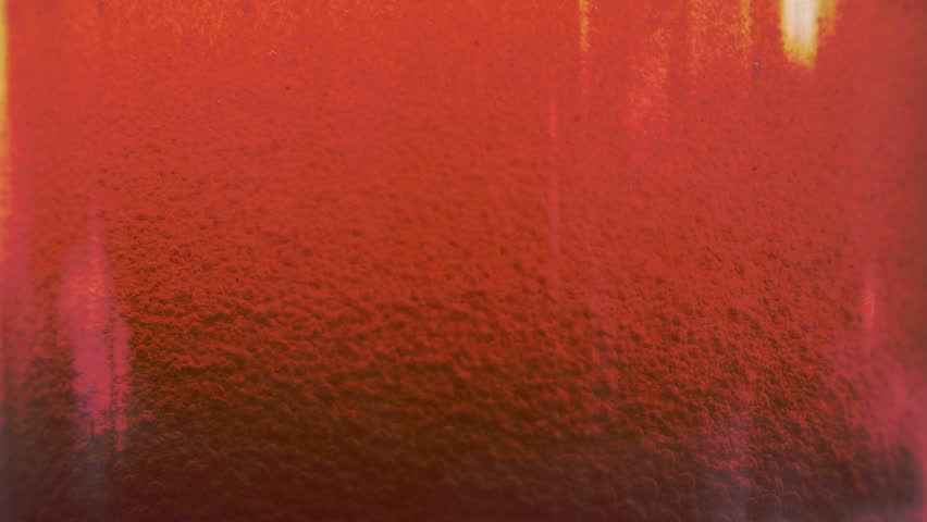 Red liquid with air bubbles #1019210533