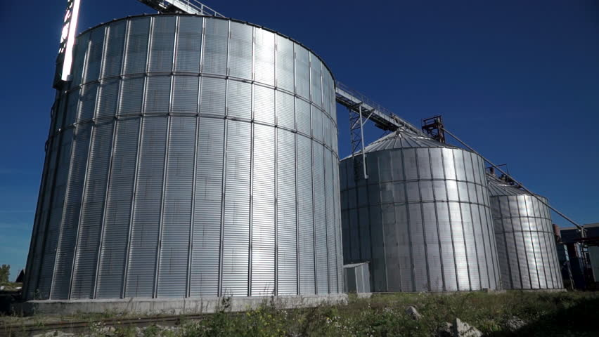 Big group of grain dryers complex for drying wheat. Modern grain silo | Shutterstock HD Video #1019244103