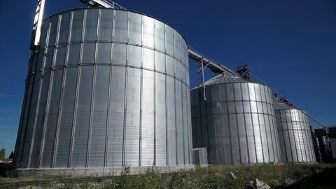 Big group of grain dryers complex for drying wheat. Modern grain silo
