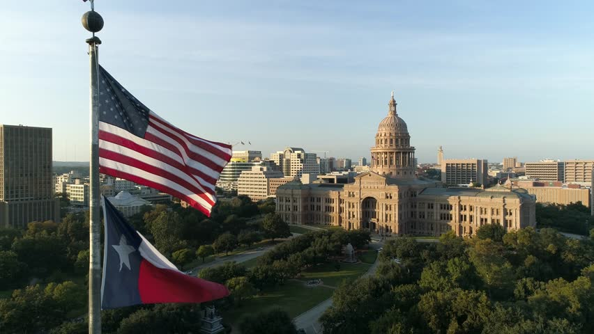 Texas Capital with Texas Flag and American Flag Aerial Slow Motion