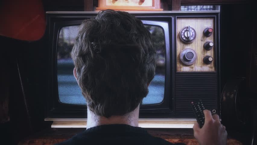 Man Changing Channels TV Remote Control Vintage Television. Man with TV remote control changing channels in a vintage style technology. Old Television | Shutterstock HD Video #1019305033