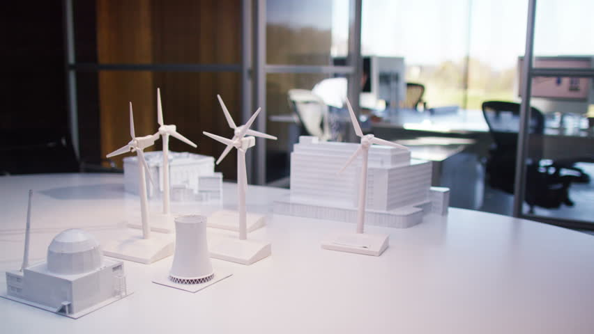 concept models of buildings and wind turbines on a desk in empty architects or engineers - Office Models Photos