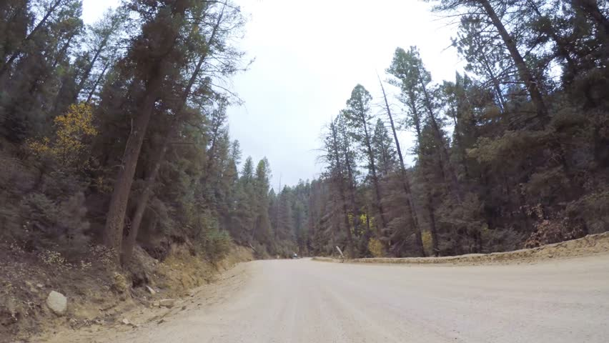 Driving on small mountain dirt roads from Colorado Springs to Cripple Creek in Autumn. | Shutterstock HD Video #1019452423