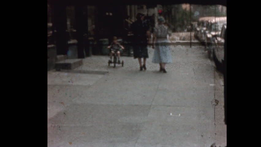 Little boy rides Tricycle down NYC street 1957 | Shutterstock HD Video #1019509993