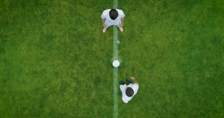 Aerial Top Down View of Soccer Field and Two Professional Teams Playing. Kick off Start of the Energetic Match on International Championship