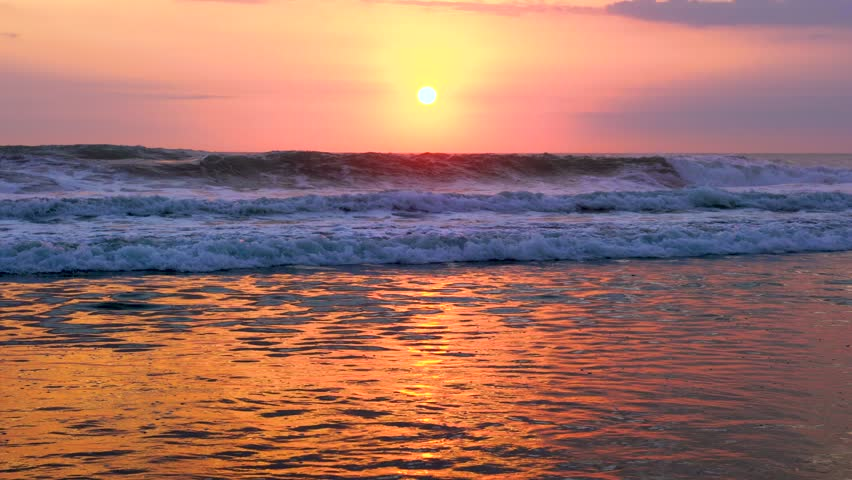 4k Water Sunset Video. Clear Tropical Island and Sunset Beach Background. Sunset Waves and Amazing Landscape Ocean. Orange Ocean Beach. Sun Rays in a Colorful Sunset Background. Beautiful Sky