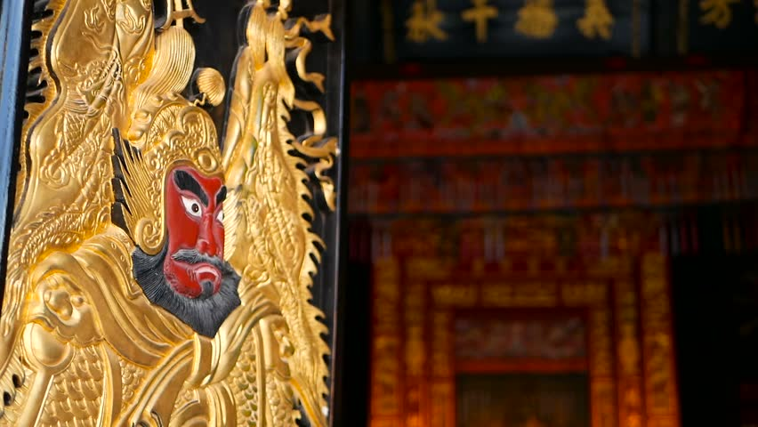 Wooden gates decorated with traditional chinese ancient holy door gods guardians Qin Shubao and Yuchi Jingde Gong. Entrance to chinese shrine with golden warrior protector angel. Tang Dynasty General