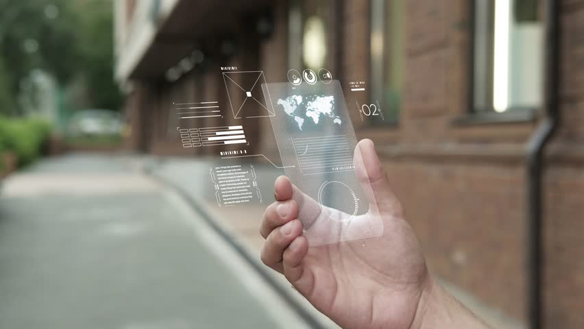 Future is now. Man using smartphone with futuristic touch screen. Closeup of a male's hand holding a mobile telephone. Concept of the near future and technologies. White screen backlight | Shutterstock HD Video #1019581573