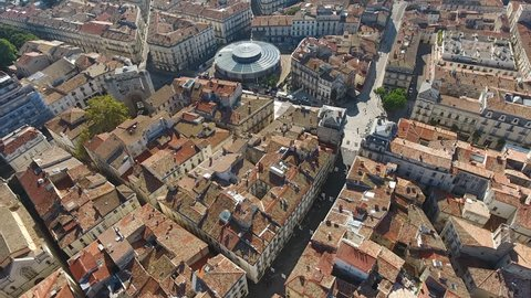 Photovoltaic roof panels on a circular building Montpellier aerial drone