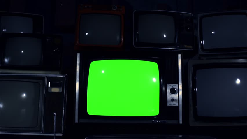 "80s TV Green Screen with Many 80s TVs. Dolly Out. Night Tone. Ready to Replace Green Screen With any Footage or Picture you Want. You Can Do it With ""Keying"" (Chroma Key) Effect in After Effect. 