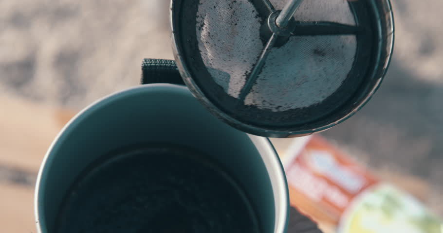 Camper using french press coffee at campsite | Shutterstock HD Video #1019634283