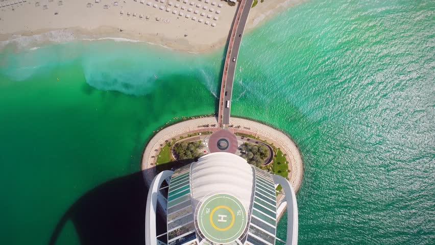 DUBAI, U.A.E - MAY 5 2018: Aerial view of road going towards luxurious Burj Al Arab Hotel in the bay of Dubai.