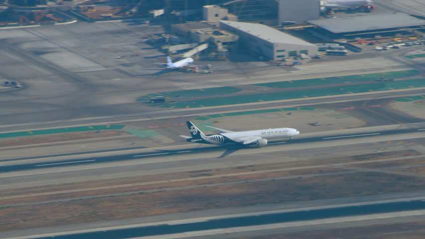 Los Angeles, California CIRCA - 2018. Aerial view of airplane taking off into clouds at LAX runway on a sunny day in Los Angeles, California. Shot on 4K RED camera.