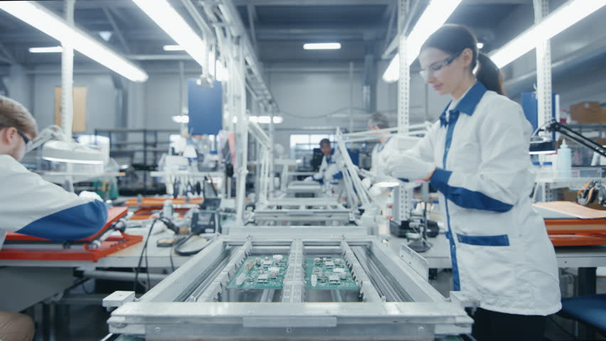 Time Lapse of Electronics Factory Workers Assembling Circuit Boards by Hand While it Moves on the Assembly Line. High Tech Factory Facility.  | Shutterstock HD Video #1019784463