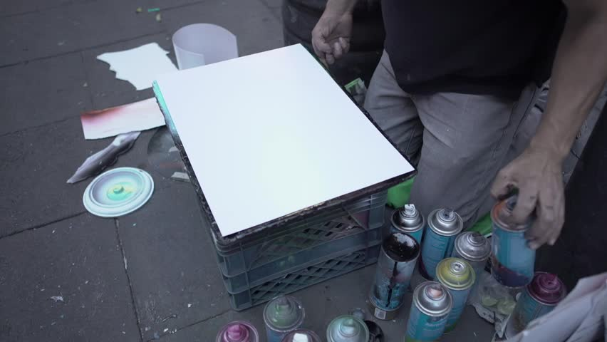 Focused and inspired man making a painting | Shutterstock HD Video #1019818063