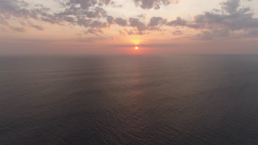 Aerial view sunset over ocean. seascape Colorful sunset over the sea in the tropics | Shutterstock HD Video #1019914783