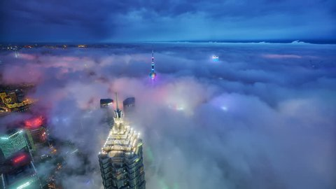SHANGHAI CHINA- CIRCA JUNE 2017: Over the sea of clouds, aerial view of the modern buildings with Huang-Pu River circa June 2017 in Shanghai, China.