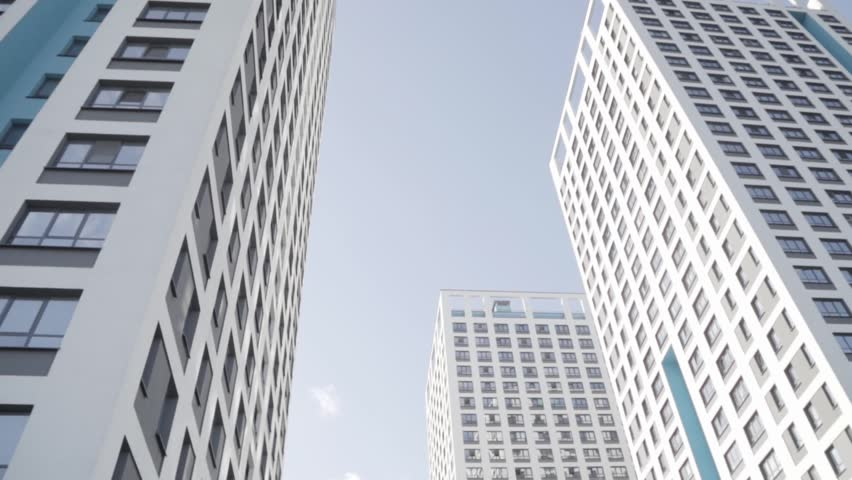 Skyscrapers in the business district of New York city on a bright blue sky background. Frame. Modern buildings in a big city center, concepts of economics, business. | Shutterstock HD Video #1020039463