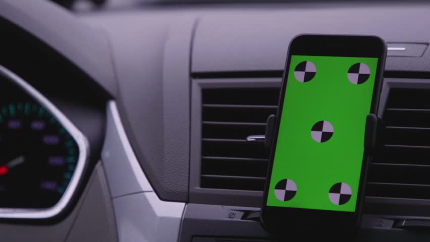 Phone on Car Dashboard Green Screen