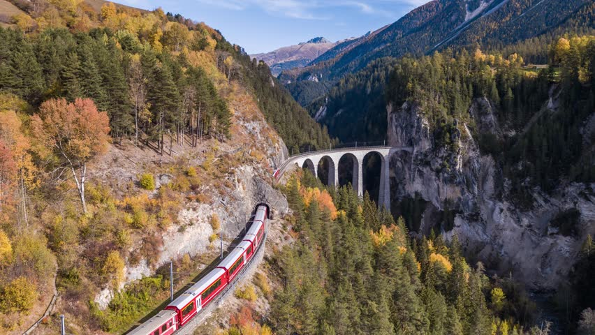 Following a train on the viaduct Landwasser in Swiss mountains during the autumn. Filmed with the Inspire 2 drone in 5.2k RAW resolution and downscaled to 4k. #1020073123