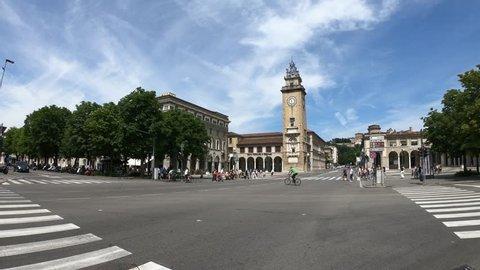 Bergamo / Lombardy / Italy - June 2018: POV walking through near the Torre dei Caduti (Tower of the Fallen) and Quadriportico gallery in Bergamo, Italy.