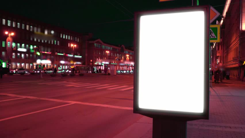 Advertising billboard standing on the street. Lightposter glowing at night for advertising. layout with white field. | Shutterstock HD Video #1020105853