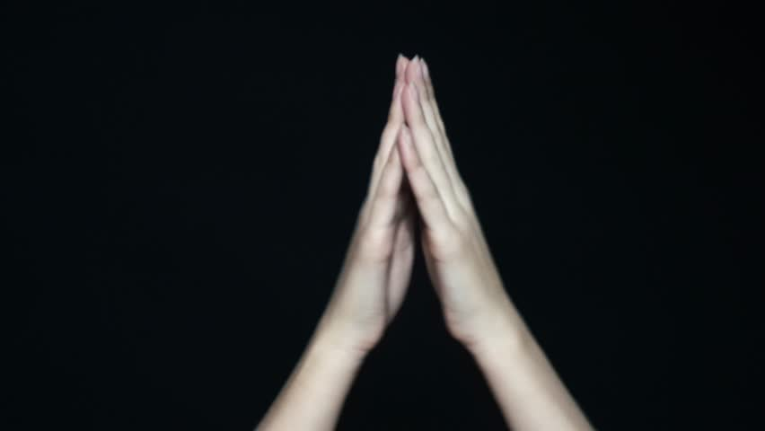 Close-up of slowing clapping hands going to applause. Isolated on black background. | Shutterstock HD Video #1020301183