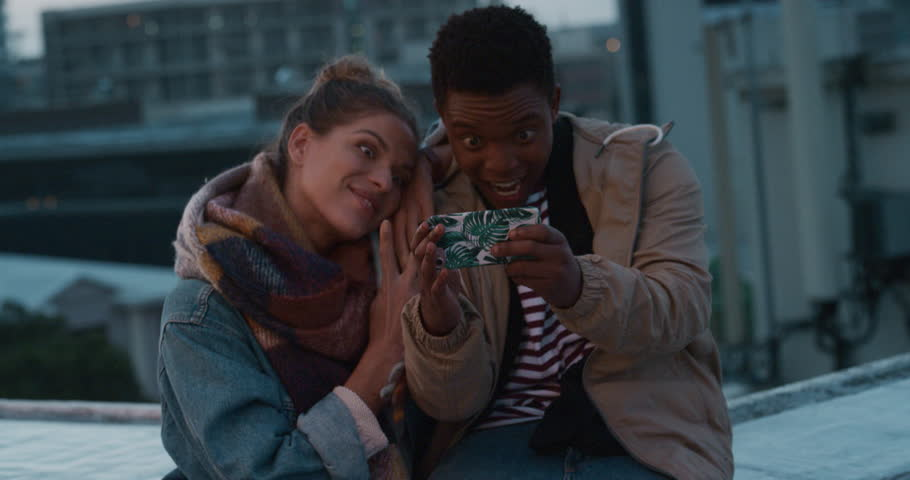 Happy friends posing for selfie photo making funny faces enjoying rooftop party celebration at sunset having fun sharing crazy weekend in city on social media | Shutterstock HD Video #1020303493