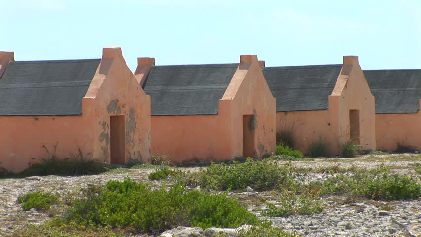 Red Slave Huts - pan to right. Shot on Bonaire, Netherlands Antilles.