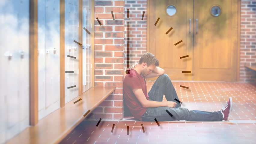 Digital animation of upset male student sitting in corridor. Clock ticking on foreground  | Shutterstock HD Video #1020405643