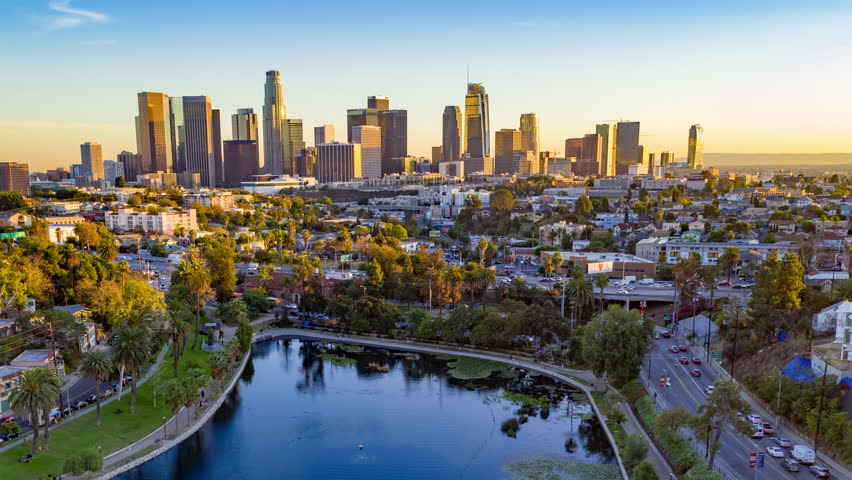 Aerial time lapse of downtown Los Angeles skyline with skyscrapers and freeway traffic below. | Shutterstock HD Video #1020431863