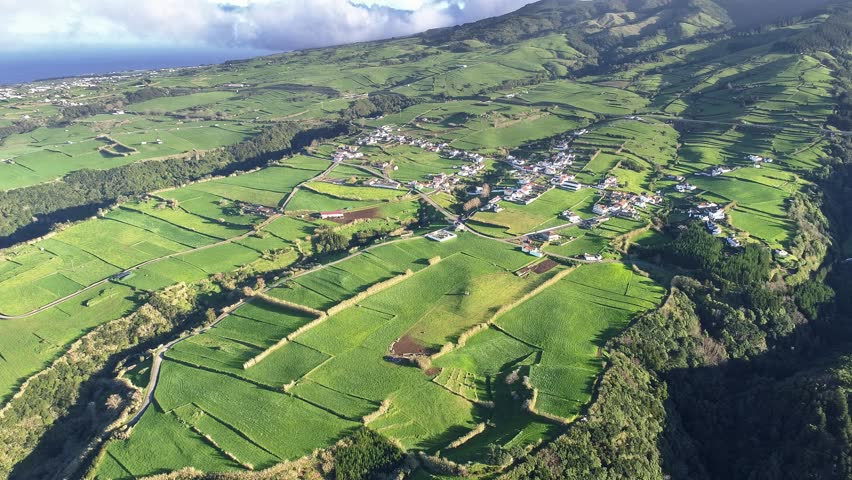Sao Miguel Island, Azores, Portugal. Villages and green fields during a bright sunny day. Aerial shot, UHD | Shutterstock HD Video #1020459223