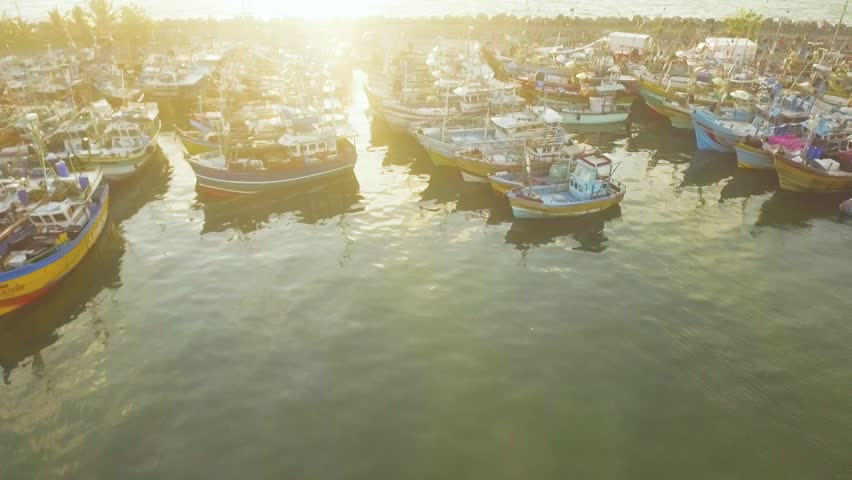 Aerial drone footage of Colorful Fishing Boats in Sri Lanka in sunset, Tangalle, Kudawella   Shutterstock HD Video #1020469153