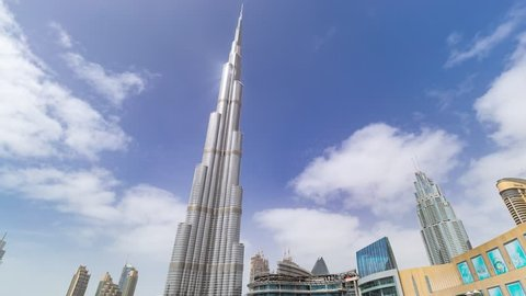 Dubai, United Arab Emirates - November 11, 2018: Timelapse hyperlapse of Burj Khalifa skyscraper tower. The tallest building in the world. Filmed during the day with fountain in front. UAE