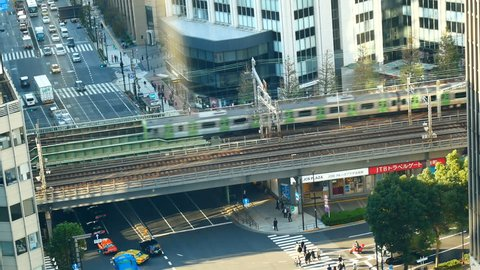 TOKYO,OCT 2018 : The central Tokyo has a rail bridge for trains running through the city. Japanese people travel by train because of comfort, on time and reduce traffic problems