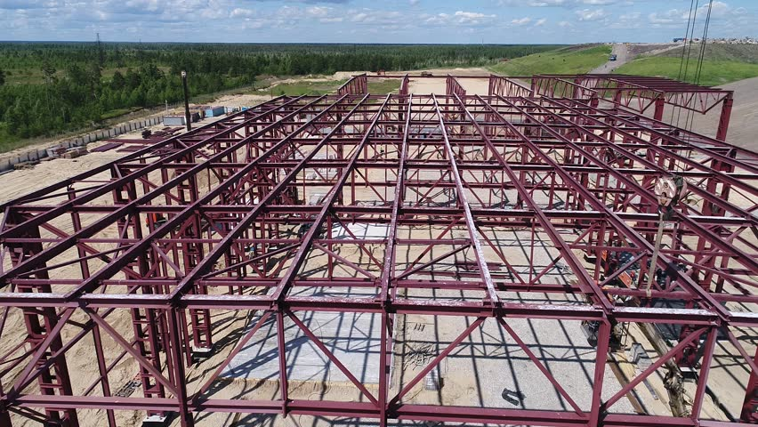 Metal frame of an industrial building under construction | Shutterstock HD Video #1020504793