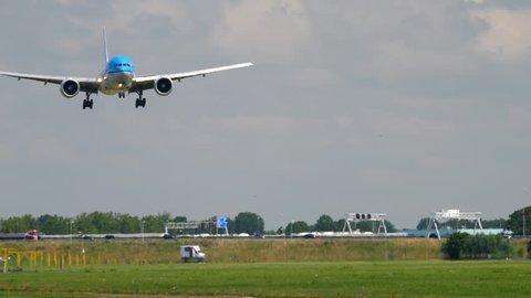 AMSTERDAM, THE NETHERLANDS - JULY 26, 2017: KLM Royal Dutch Airlines Boeing 777 PH-BQB flight KLM256 from Atlanta (ATL) landing on runway 18R Polderbaan. Shiphol Airport, Amsterdam, Holland