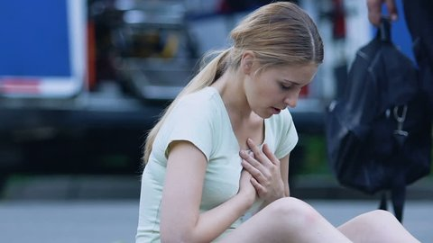 Woman hardly breathing, feeling squeezed pain in chest, risk of heart attack