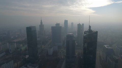 Aerial view of the city center of Warsaw. Poland. Skyscrapers stand in the fog at sunrise.